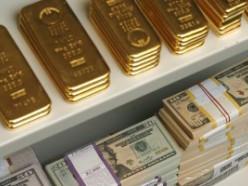 Золотовалютные резервы за июль выросли, несмотря на рекордные выплаты по долгам