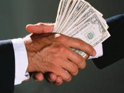 За взятку в $200 000 КГБ задержал помощника Президента